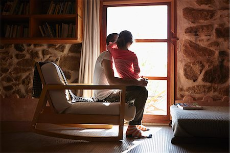 Mid adult man and daughter looking out of window Stock Photo - Premium Royalty-Free, Code: 649-07648612