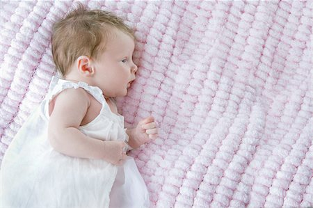 Baby girl lying on side Stock Photo - Premium Royalty-Free, Code: 649-07648644