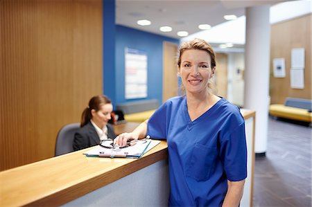 doctor in waiting room - Nurse standing in hospital waiting room Stock Photo - Premium Royalty-Free, Code: 649-07709954