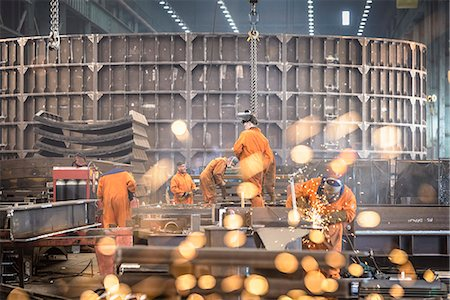 dependable - Workers grinding metal construction in marine fabrication factory Stock Photo - Premium Royalty-Free, Code: 649-07709975
