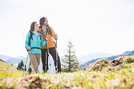 Mid adult couple nordic walking through Tegernsee, Bavaria, Germany Stock Photo - Premium Royalty-Free, Code: 649-07709985