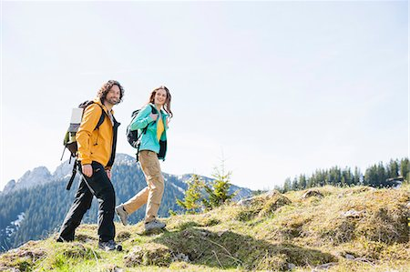 Mid adult couple nordic walking through Tegernsee, Bavaria, Germany Stock Photo - Premium Royalty-Free, Code: 649-07709987