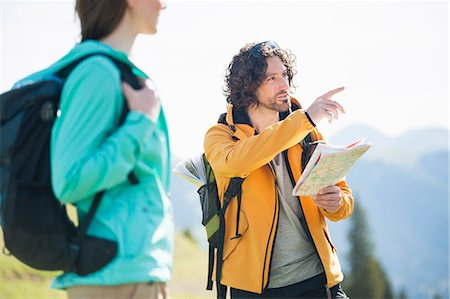 Mid adult man looking at map, pointing Stock Photo - Premium Royalty-Free, Code: 649-07709991