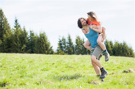 Mid adult man giving girlfriend a piggyback in Tegernsee, Bavaria, Germany Stock Photo - Premium Royalty-Free, Code: 649-07710051