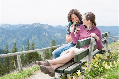 Mid adult couple smelling wildflowers, Wallberg, Tegernsee, Bavaria, Germany Stock Photo - Premium Royalty-Free, Code: 649-07710100