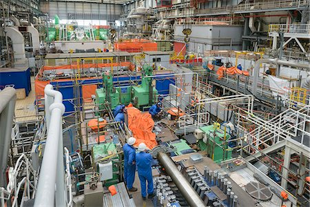 supervising - Engineers working on turbine housing repair during power station outage, high angle view Stock Photo - Premium Royalty-Free, Code: 649-07710162