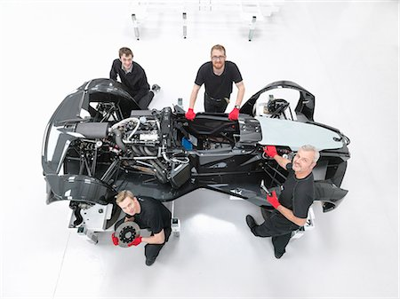 Portrait of engineers assembling supercar in sports car factory, overhead view Stock Photo - Premium Royalty-Free, Code: 649-07710216