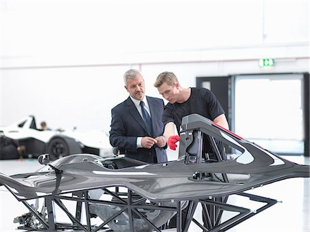 Manager and engineer inspecting carbon fibre body of supercar in sports car factory Stock Photo - Premium Royalty-Free, Code: 649-07710223