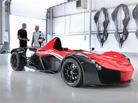 partnership - Test driver and engineer with supercar in car factory Stock Photo - Premium Royalty-Free, Code: 649-07710238