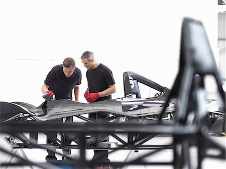 Engineers inspecting carbon fibre car body shell in sports car factory Stock Photo - Premium Royalty-Free, Code: 649-07710241