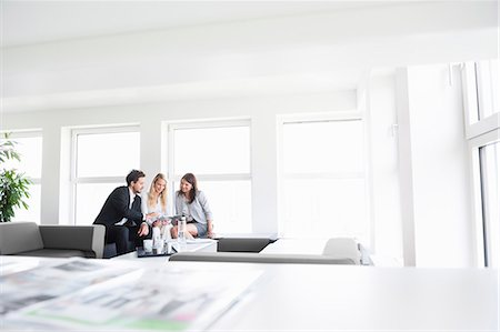 Business colleagues in office Stock Photo - Premium Royalty-Free, Code: 649-07710337