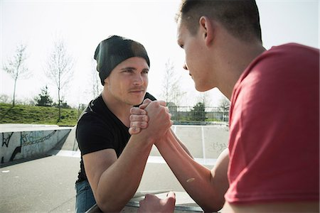 Young men arm-wrestling in skatepark Stock Photo - Premium Royalty-Free, Code: 649-07710454