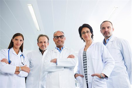 Doctors posing for group portrait Stock Photo - Premium Royalty-Free, Code: 649-07710493