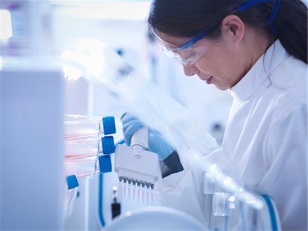 science & technology - Scientist making cell culture inside laboratory workstation, close up Stock Photo - Premium Royalty-Free, Code: 649-07710514