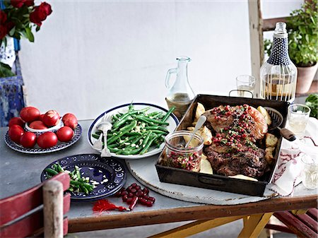 delicious - Still life of roasted lamb with pomegranate seeds and vegetables Stock Photo - Premium Royalty-Free, Code: 649-07710526