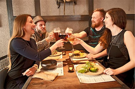 Friends toasting at hipster bar Stock Photo - Premium Royalty-Free, Code: 649-07710590
