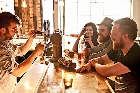 Friends drinking beer at hipster bar Stock Photo - Premium Royalty-Free, Code: 649-07710591