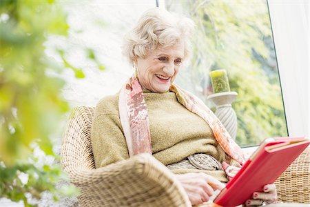 sitting - Senior woman using digital tablet Stock Photo - Premium Royalty-Free, Code: 649-07710593