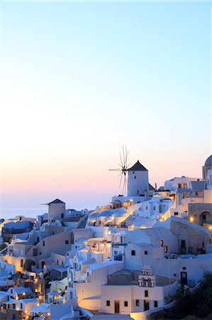 Oia town and windmill at dusk, Santorini, Cyclades Islands, Greece Stock Photo - Premium Royalty-Free, Code: 649-07710649