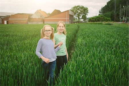 Portrait of nine year old girl and sister on field path Stock Photo - Premium Royalty-Free, Code: 649-07710664