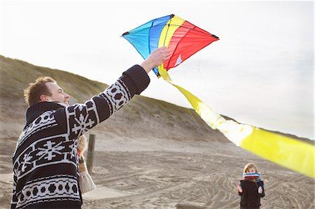 Mid adult man and son preparing to fly kite on beach, Bloemendaal aan Zee, Netherlands Stock Photo - Premium Royalty-Free, Code: 649-07710719