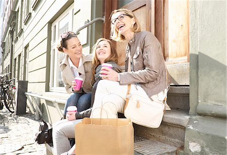family  fun  outside - Three generation females drinking takeaway coffee on street Stock Photo - Premium Royalty-Free, Code: 649-07710766