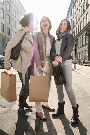 Three generation females with shopping bags on city street Stock Photo - Premium Royalty-Free, Code: 649-07710767