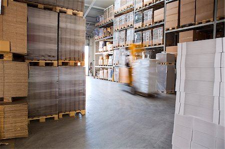 paper - Blurred forklift truck in storage warehouse Stock Photo - Premium Royalty-Free, Code: 649-07710763