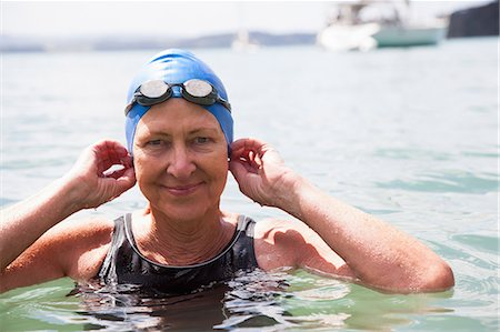 Portrait of senior woman swimmer in sea Stock Photo - Premium Royalty-Free, Code: 649-07710774