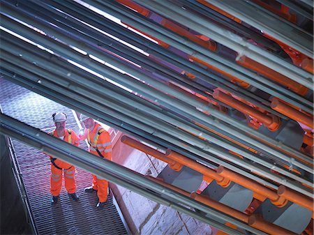 Civil engineers using torch to  inspect cable anchorage in suspension bridge. The Humber Bridge, UK, built in 1981 was the world's largest single-span suspension bridge Stock Photo - Premium Royalty-Free, Code: 649-07710813