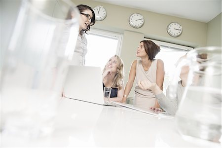 Four businesswomen meeting in conference room Stock Photo - Premium Royalty-Free, Code: 649-07736464