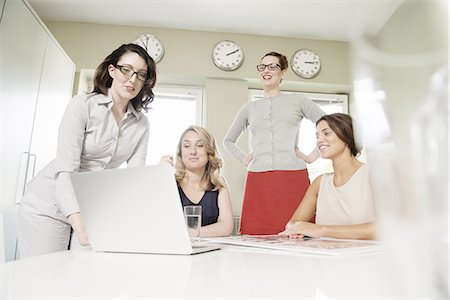 designer (female) - Four businesswomen looking at laptop Stock Photo - Premium Royalty-Free, Code: 649-07736463