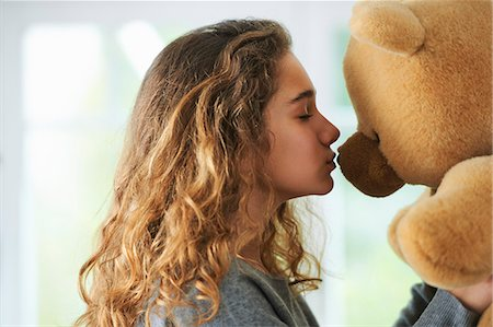 preteen kissing - Portrait of young girl kissing teddy bear Stock Photo - Premium Royalty-Free, Code: 649-07736667