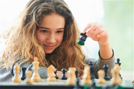 strategy - Portrait of young girl playing chess Stock Photo - Premium Royalty-Free, Code: 649-07736670