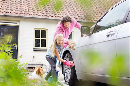 Girl helping father wash his car Stock Photo - Premium Royalty-Free, Code: 649-07736710