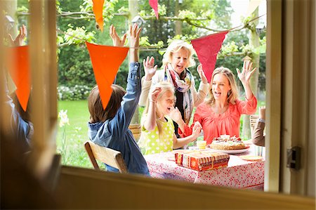 Family singing and cheering at birthday party Stock Photo - Premium Royalty-Free, Code: 649-07736728