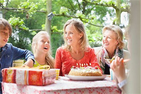 Girl making birthday wish with her family at birthday party Stock Photo - Premium Royalty-Free, Code: 649-07736730