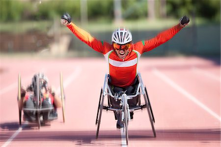 Athlete at finishing line in para-athletic competition Stock Photo - Premium Royalty-Free, Code: 649-07736742