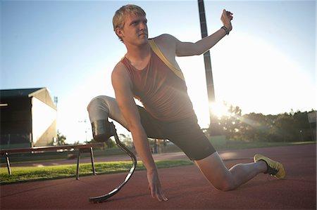 stretching (people exercising) - Sprinter stretching Stock Photo - Premium Royalty-Free, Code: 649-07736750