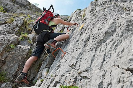 Femal climber on via ferrata Che Guevara with fixed rungs, Monte Casale, Trentino, Italy Stock Photo - Premium Royalty-Free, Code: 649-07736785