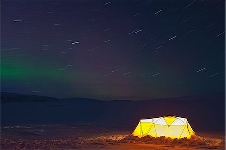 Illuminated tent and northern lights in clear sky, Langjokull, South West Iceland Stock Photo - Premium Royalty-Free, Code: 649-07736799