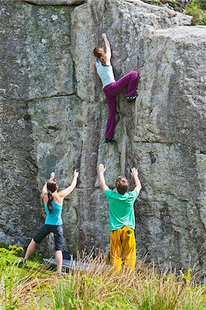 Young female climber bouldering on RAC boulders, spotted by other climbers, Snowdonia, North Wales, UK Stock Photo - Premium Royalty-Free, Code: 649-07736805