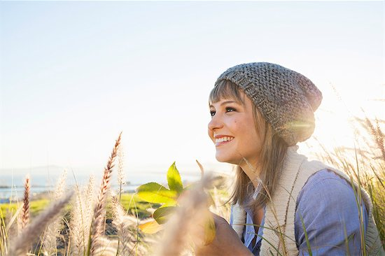 Young woman enjoying view in fields Stock Photo - Premium Royalty-Free, Image code: 649-07737006