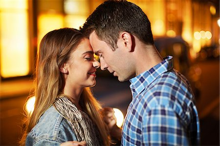 Romantic couple face to face city street at night Stock Photo - Premium Royalty-Free, Code: 649-07737020