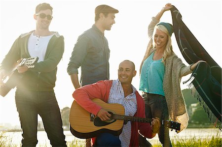 Four adult friends with acoustic guitar and picnic blanket on Bournemouth beach, Dorset, UK Stock Photo - Premium Royalty-Free, Code: 649-07760809