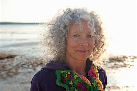 Close up of mature woman by beach Stock Photo - Premium Royalty-Free, Code: 649-07760817