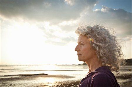 Mature woman enjoying beach Stock Photo - Premium Royalty-Free, Code: 649-07760824
