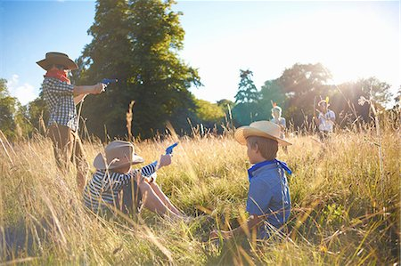 Group of young boys playing in a field Stock Photo - Premium Royalty-Free, Code: 649-07760865