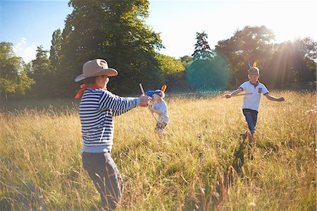 Group of young boys playing in a field Stock Photo - Premium Royalty-Free, Code: 649-07760866