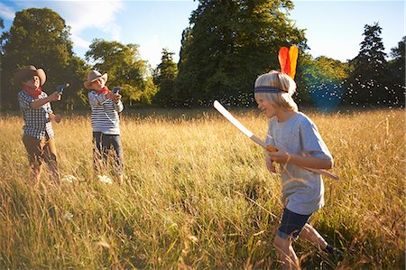 Group of young boys playing in field Stock Photo - Premium Royalty-Free, Code: 649-07760867